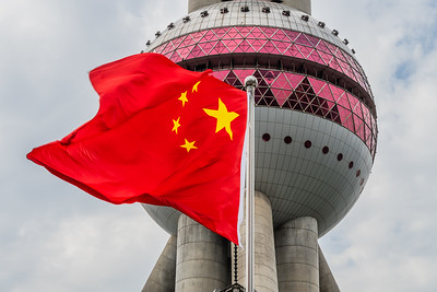 Chinese flag and Oriental Pearl Tower.