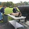 Lee Kellaway prepares the roaster for the pig roast that starts today at 11:00 am at Family Life.