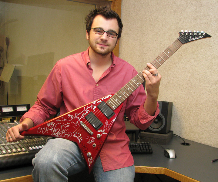 "Tim showing off the Jackson ""Rhodes edition of the Flying-V"" guitar."