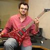 """Tim showing off the Jackson """"Rhodes edition of the Flying-V"""" guitar."""