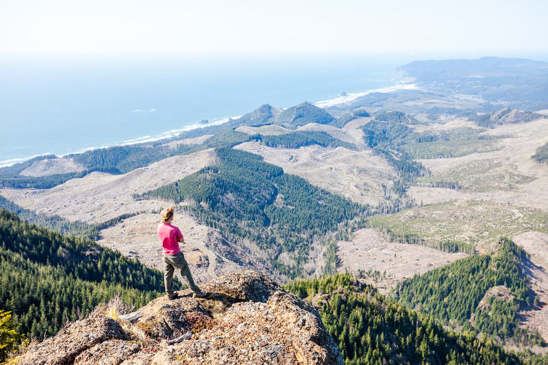 Max Broderick looks north over the Oregon Coast from atop Indian Chieftain peak. Below he can see patches of forest and clearcut, Silver Point, Double Peak, Cannon Beach with Haystack Rock, Ecola State Park and Tillamook Head.