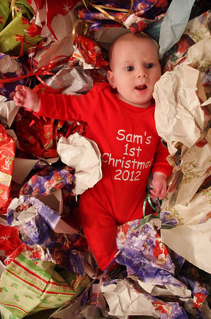Day 148 (12/25) - Like most babies, Sam's favorite part of Xmas was rolling around in all the wrapping paper.
