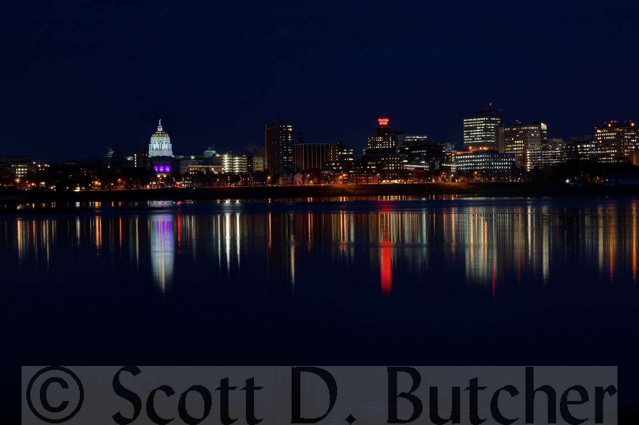 Harrisburg, Pennsylvania skyline at twilight by Scott D. Butcher. Photo taken from the West Shore of the Susquehanna River.