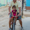 Dad and daughter on bicycle