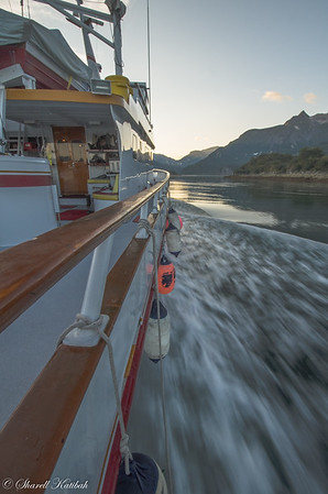 Boat, buoys, and wake