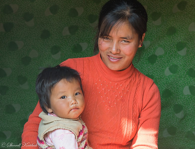 Woman in Orange Sweater with Baby, Aye, Chin State