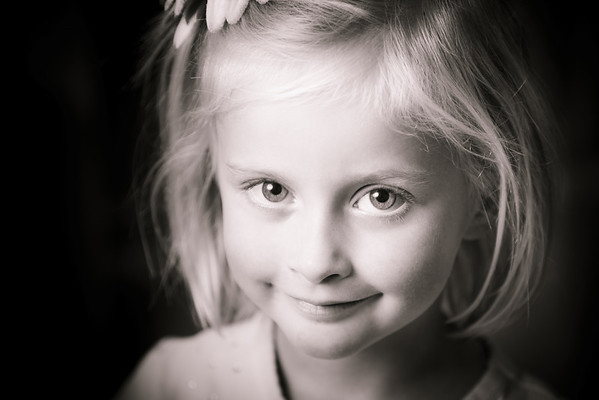 I recently purchased some new (used) studio lights and wanted to try them out. My little girl obliged in posing for a few minutes. Isn't she just the cutest...
