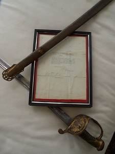 William Wallace's Civil War sword, scabbard, and letter of discharge.