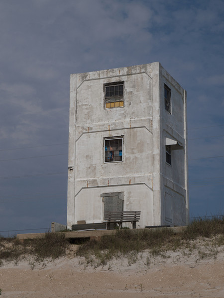 After World War II, the U.S. Navy took over the island and began Operation Bumblebee with Johns Hopkins University, which was the beginning of the U.S space program. Along the Topsail Island oceanfront, rocket launching pads were built, and concrete observation towers, such as this, were built throughout the island to monitor the experimental launchings. Over 200 rocket launchings took place on the island between 1946 and 1948. When the testing program was dismantled, the government sold the island to the public. Many of the original military structures are still standing, and have been repurposed into apartments, or annexed to larger dwellings. Topsail Island, North Carolina.
