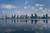 City skyline of high rise buildings on the lagoon in Sharjah, UAE.