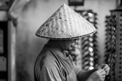 Salesman wearing local hat