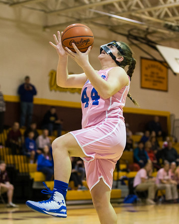 Skarpsville's Izzy Schell goes in for a layup.