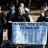 DAVID BORRELLI - THE CENTRAL RECORD<br /> Shawnee High School administrators and teachers lead the graduates into the stadium.