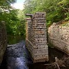 A small plaque notes the significance of the Shawsheen River Aqueduct of the Middlesex Canal. -- photo by Mary Leach