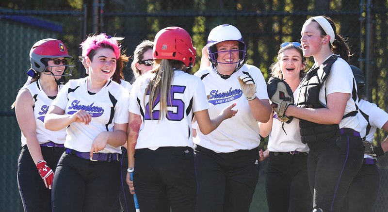 . Surrounded in celebration.  In the final inning of the game, Shawsheen\'s senior captain, Katelyn Logue, center, bats in three runs to close out the game against Innovation Academy in the 5th inning, winning the game 12-0, now maintaining a five game winning streak.  Photo:  SUN/Scot Langdon