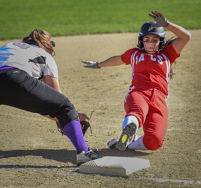 . Innovation Academy\'s Yanessa Rowe, right, makes a safe slide into third base against Shawsheen Tech\'s senior, Katelyn Logue, during Monday\'s game at the Billerica field.  Photo:  SUN/Scot Langdon