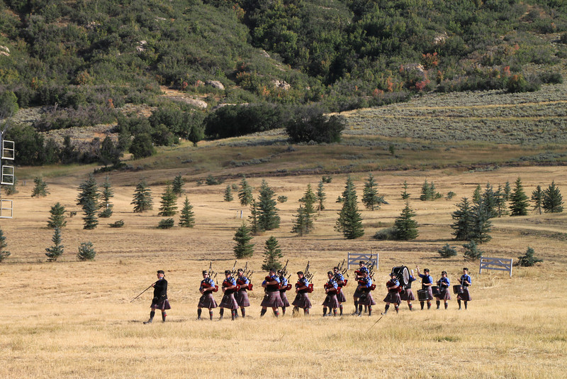 The Salt Lake Scots Bagpipe Band marches down the hill to join the medals ceremonies