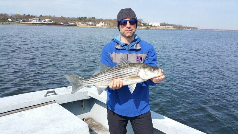 nephew Peter and a Striped Bass