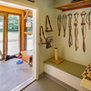 Louise's Tack Room is a tribute to founder Joy Smith's beloved cat Louise who was the inspiration for FieldHaven and the cat in FieldHaven's logo.  Design is by Jane Cozart.  Cats have free choice to be indoors or outdoors by way of  a cat door in each suite.  During nice weather the doors are opened for maximum air flow.  FieldHaven has an HVAC system designed to provide the appropriate rate of air exchange to minimize the spread of disease.