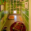 The Kitten Central Suite with design by Deborah Klenzman of Progressive Portraits.  Each Suite has a white board for volunteers and staff to write notes and observations while visiting or caring for the cats.  The shelves for the occupant to have a high perch have been removed because at the time this photo was taken the occupant was recovering from orthopedic surgery and jumping onto high places was not  part of his physical therapy!