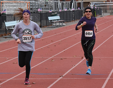 STAN HUDY - SHUDY@DIGITALFIRSTMEDIA.COM Runners racing towards the finish line of the Shenendehowa Veteran's Day Dash 5k on the Shenendehowa campus, Friday, Nov. 11, 2016.