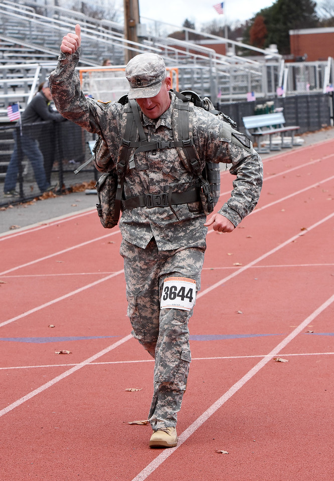 STAN HUDY - SHUDY@DIGITALFIRSTMEDIA.COMSargent First Class Douglas Kirsch heads towards the finish line at the annual Shenendehowa Veteran's Day 5k Dash. His time: 30:09