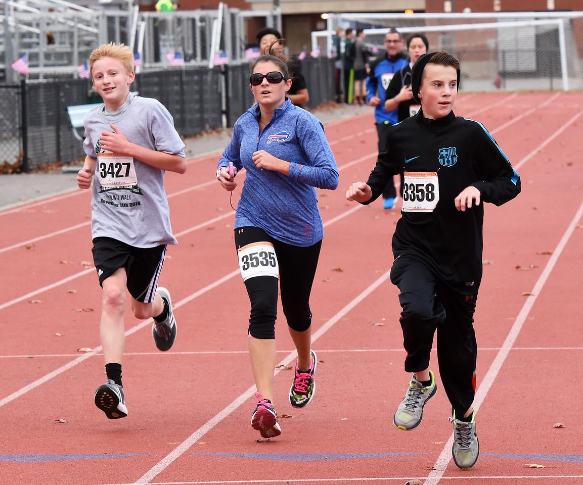 STAN HUDY - SHUDY@DIGITALFIRSTMEDIA.COMAmanda Sly (3535) races towards the finish line of the Shenendehowa Veteran's Day Dash 5k on the Shenendehowa campus in 25:36.