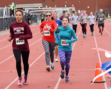 STAN HUDY - SHUDY@DIGITALFIRSTMEDIA.COM Lila McHale Carter runs towards the finish line of the Shenendehowa Veteran's Day Dash 5k on the Shenendehowa campus in 26:14.