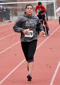 STAN HUDY - SHUDY@DIGITALFIRSTMEDIA.COM Sophia Caputo runs towards the finish line of the Shenendehowa Veteran's Day Dash 5k on the Shenendehowa campus in 26:31.