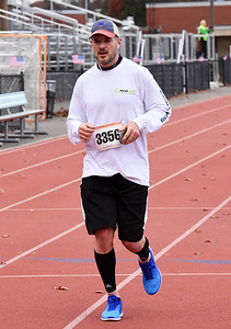 STAN HUDY - SHUDY@DIGITALFIRSTMEDIA.COM Mark Ayotte runs towards the finish line of the Shenendehowa Veteran's Day Dash 5k on the Shenendehowa campus in 25:44.