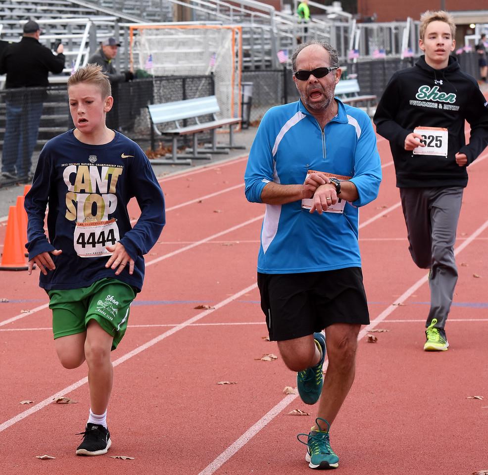 STAN HUDY - SHUDY@DIGITALFIRSTMEDIA.COMDanny Weyrauch races towards the finish line of the Shenendehowa Veteran's Day Dash 5k on the Shenendehowa campus in 25:15.