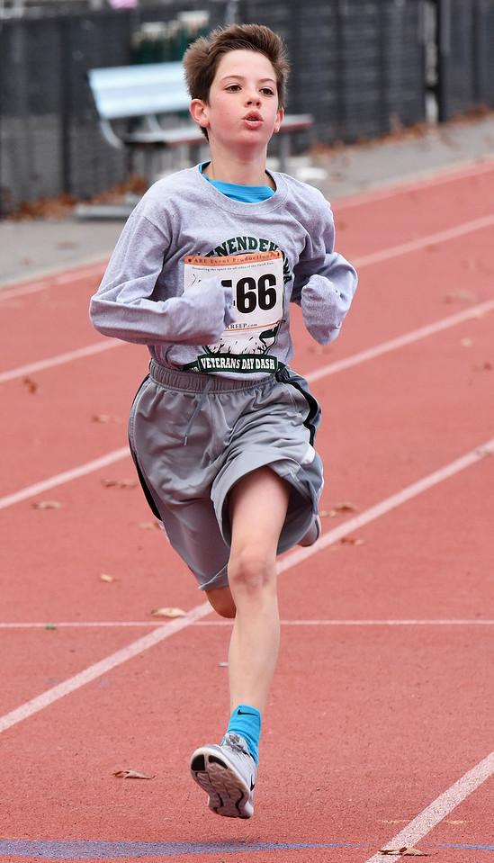 STAN HUDY - SHUDY@DIGITALFIRSTMEDIA.COMA young runner races towards the finish line of the Shenendehowa Veteran's Day Dash 5k on the Shenendehowa campus.