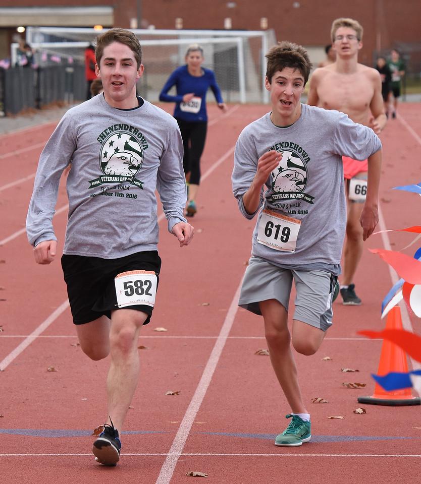 STAN HUDY - SHUDY@DIGITALFIRSTMEDIA.COMRunners racing towards the finish line of the Shenendehowa Veteran's Day Dash 5k on the Shenendehowa campus, Friday, Nov. 11, 2016.
