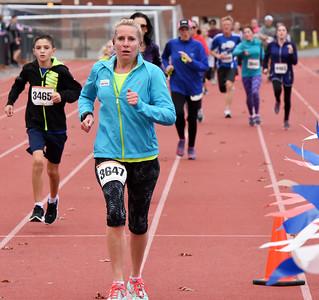 STAN HUDY - SHUDY@DIGITALFIRSTMEDIA.COM Marcie Alexander runs towards the finish line of the Shenendehowa Veteran's Day Dash 5k on the Shenendehowa campus in 26:06.