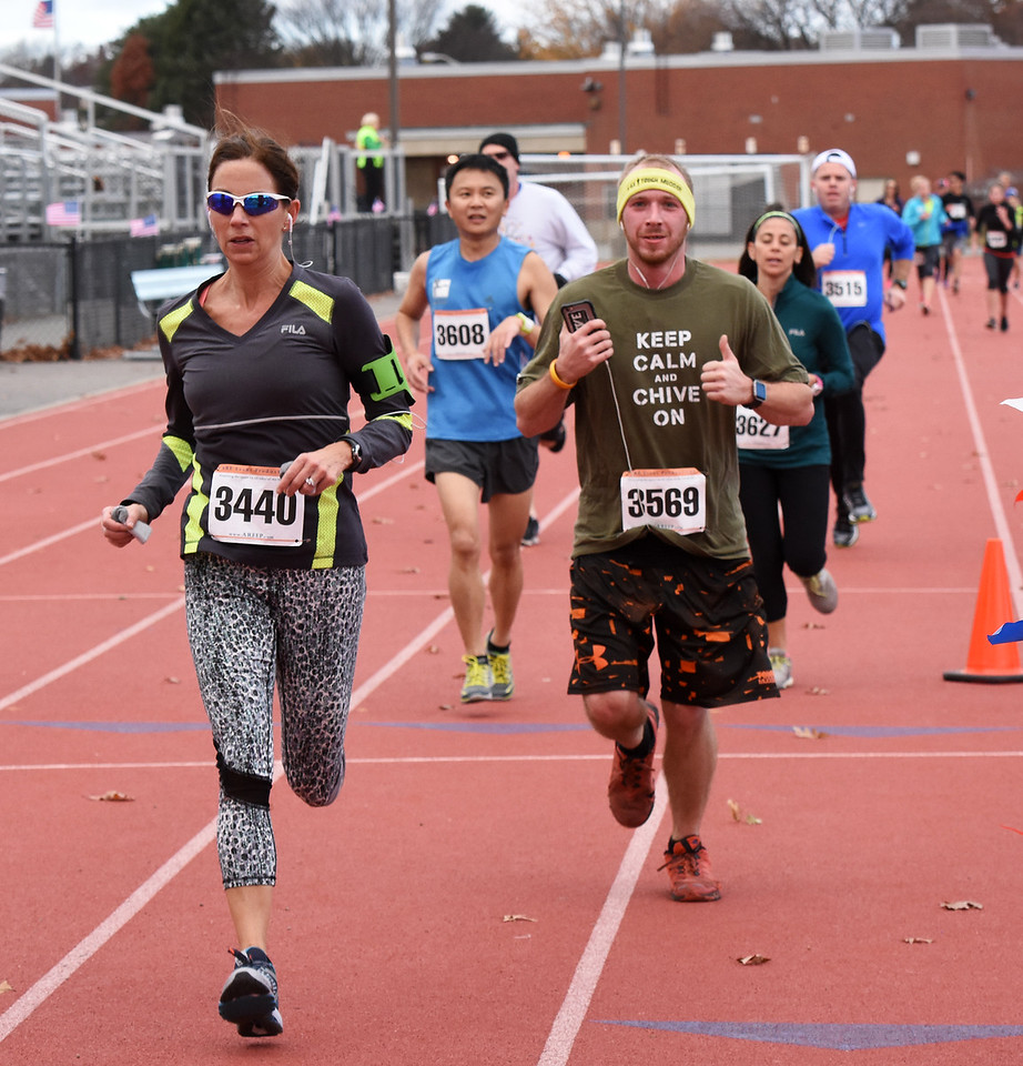 STAN HUDY - SHUDY@DIGITALFIRSTMEDIA.COMSean Norris gives a thumbs up as he heads towards the finish line of the Shenendehowa Veteran's Day Dash 5k on the Shenendehowa campus in 25:48.