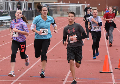 STAN HUDY - SHUDY@DIGITALFIRSTMEDIA.COM Runners racing towards the finish line of the Shenendehowa Veteran's Day Dash 5k on the Shenendehowa campus, Friday, Nov. 11, 2016.