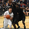 STAN HUDY - SHUDY@DIGITALFIRSTMEDIA.COM<br /> Shenendehowa senior guard Luke Hicks takes the body contact from Green Tech's Amil Rodriguez and grimaces as he drives towards the basket Sunday afternoon in the first quarter. It set the tone for the entire contest.