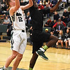 STAN HUDY - SHUDY@DIGITALFIRSTMEDIA.COM<br /> Shenendehowa senior guard Jaia Benson goes up for a lay-up in the first quarter Sunday against Green Tech senior Amil Rodriguez. He was unsuccessful as Rodriguez blocked the shot.