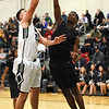 STAN HUDY - SHUDY@DIGITALFIRSTMEDIA.COM<br /> Shenendehowa big man, 6-foot 8-inch Mike Pizziketti was challenged during his jump shot by Green Tech's 6-foot-4 George Varmah during Sunday's non-league contest at High School East.
