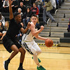 STAN HUDY - SHUDY@DIGITALFIRSTMEDIA.COM<br /> Shenendehowa junior Jake Dzikas looks to get around a Green Tech defender along the baseline during the first half of Sunday's non-league tilt at High School East.