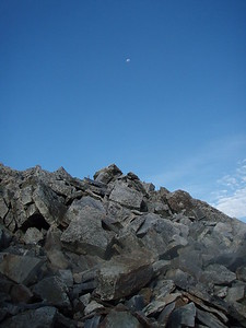 Last night's moon still visible over the rockpile.