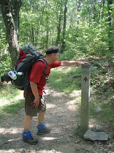 These posts have a metal band at the top imprinted with the names of the trails for direction.