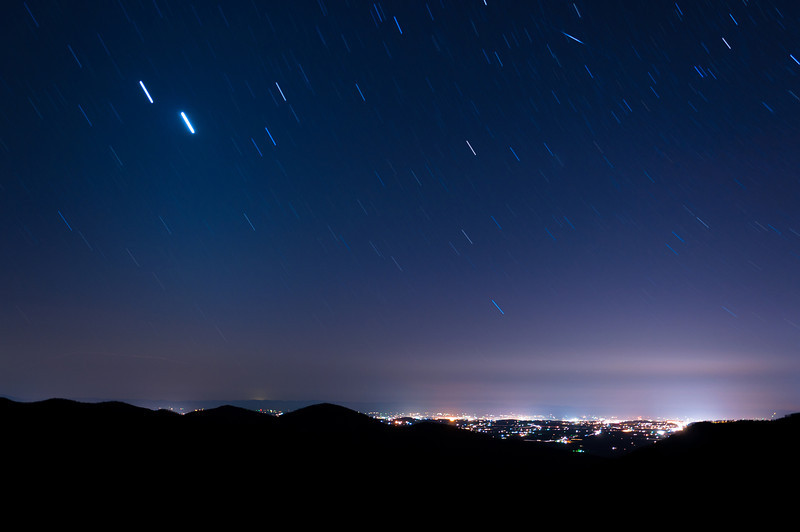 Startrails over Harrisonburg, Virginia at night, seen from Skyline Drive in Shenandoah National Park, Virginia