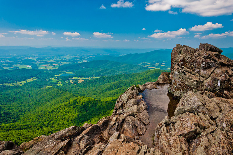 Water puddle and view from cliffs on Little Stony Man Mountain, in Shenandoah National Park, Virginia.