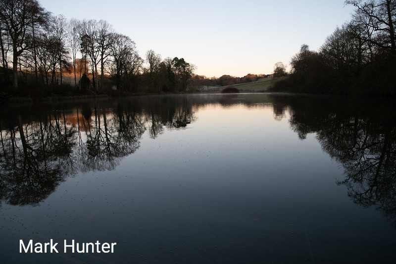 UK weather. Sunrise over a lake in rural Oxfordshire