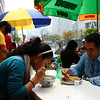 Ramin Razavifar (right) and a friend have lunch outdoors under the shade