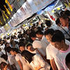 Locals in white enjoying the street market at night in Phuket Town.