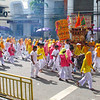 A parade makes its way through the streets of Phuket Town.