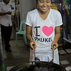 A local girl cooks Chinese dumplings at the night market in Phuket Town.