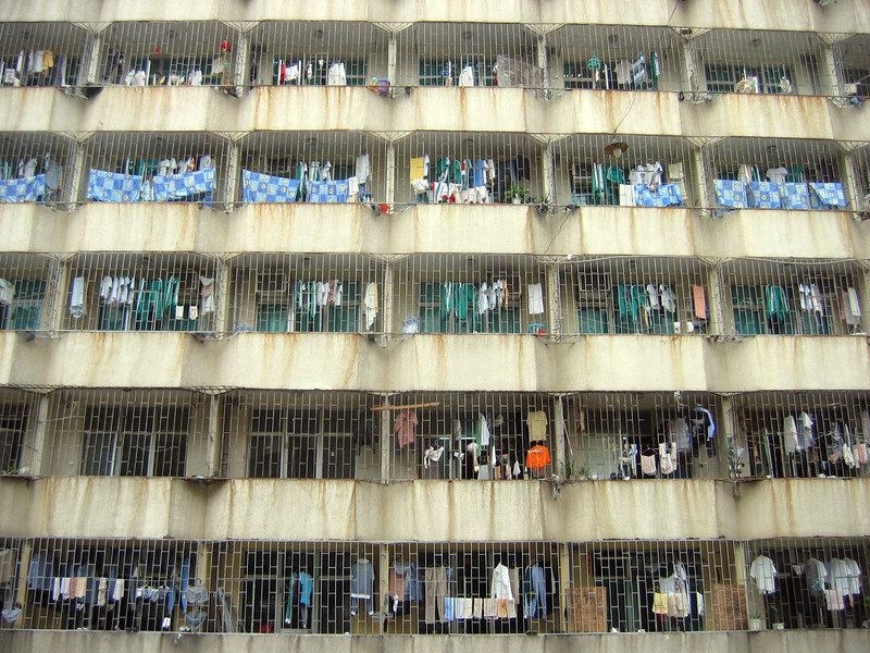 Clothes hangs out to dry in a typical apartment complex in Liantang, Shenzhen. Most apartments like this have metal bars to prevent theft.